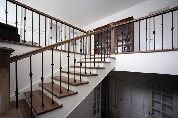Wooden staircase renovation leading to a basement suite. This home renovation was done in Burnaby.