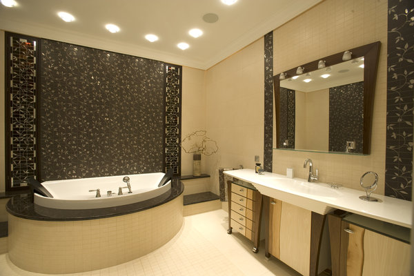 Modern bathroom renovation. Tiles, bath tub, and a vanity were installed in this beautiful luxury Burnaby home.